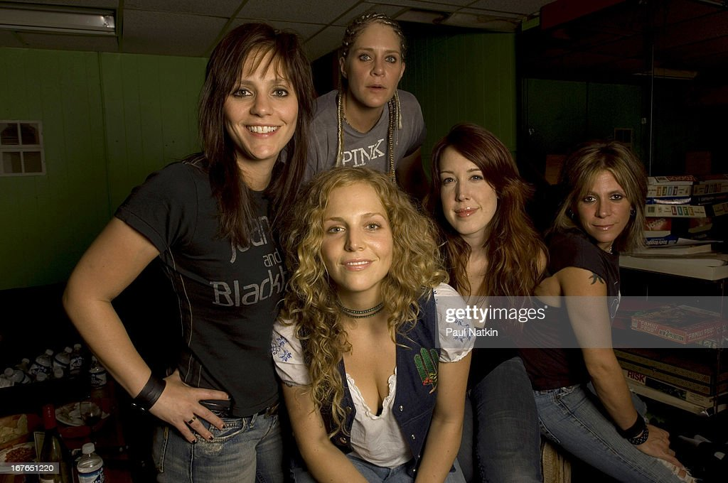 Portrait of American rock band Antigone Rising as they pose backstage at Martyr's nightclub Chicago Illinois October 3 2006 Pictured are from left...