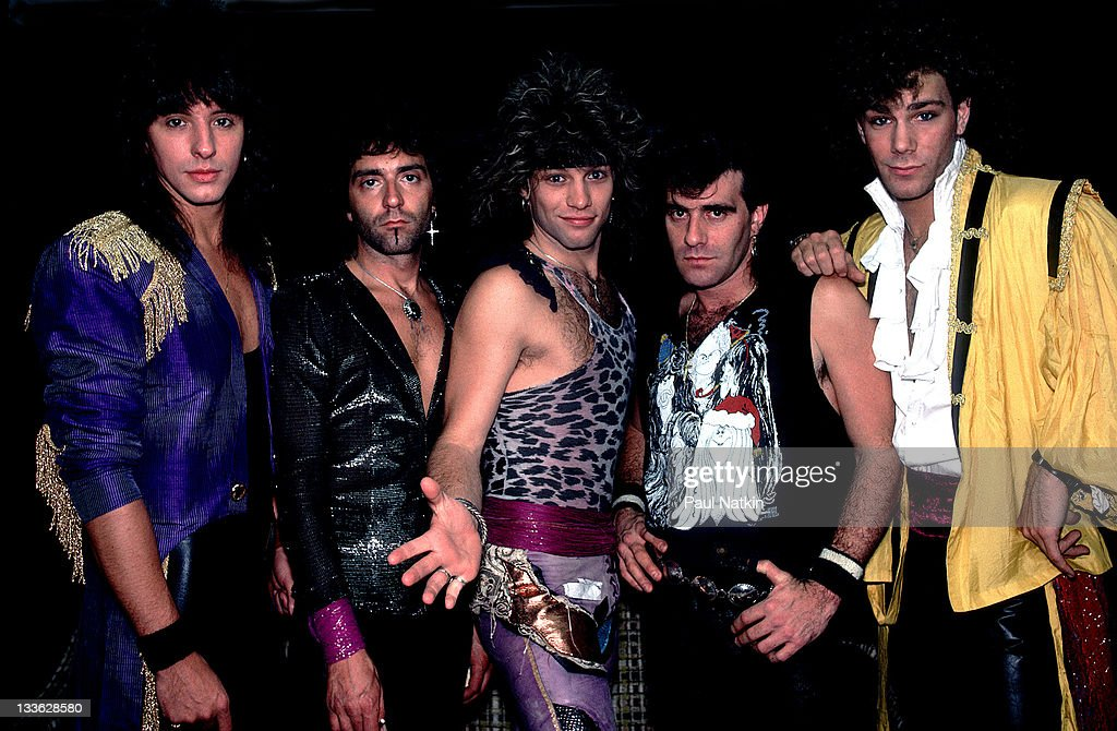 Portrait of American rock band Bon Jovi backstage before a performance at Summerfest, Milwaukee, Wisconsin, June 29, 1985. Pictured are, from left,<a gi-track='captionPersonalityLinkClicked' href=/galleries/search?phrase=Alec+John+Such&family=editorial&specificpeople=1106553 ng-click='$event.stopPropagation()'>Alec John Such</a>, <a gi-track='captionPersonalityLinkClicked' href=/galleries/search?phrase=Richie+Sambora&family=editorial&specificpeople=204195 ng-click='$event.stopPropagation()'>Richie Sambora</a>, <a gi-track='captionPersonalityLinkClicked' href=/galleries/search?phrase=Jon+Bon+Jovi&family=editorial&specificpeople=201527 ng-click='$event.stopPropagation()'>Jon Bon Jovi</a>, <a gi-track='captionPersonalityLinkClicked' href=/galleries/search?phrase=Tico+Torres&family=editorial&specificpeople=241551 ng-click='$event.stopPropagation()'>Tico Torres</a>, and <a gi-track='captionPersonalityLinkClicked' href=/galleries/search?phrase=David+Bryan&family=editorial&specificpeople=211281 ng-click='$event.stopPropagation()'>David Bryan</a>.