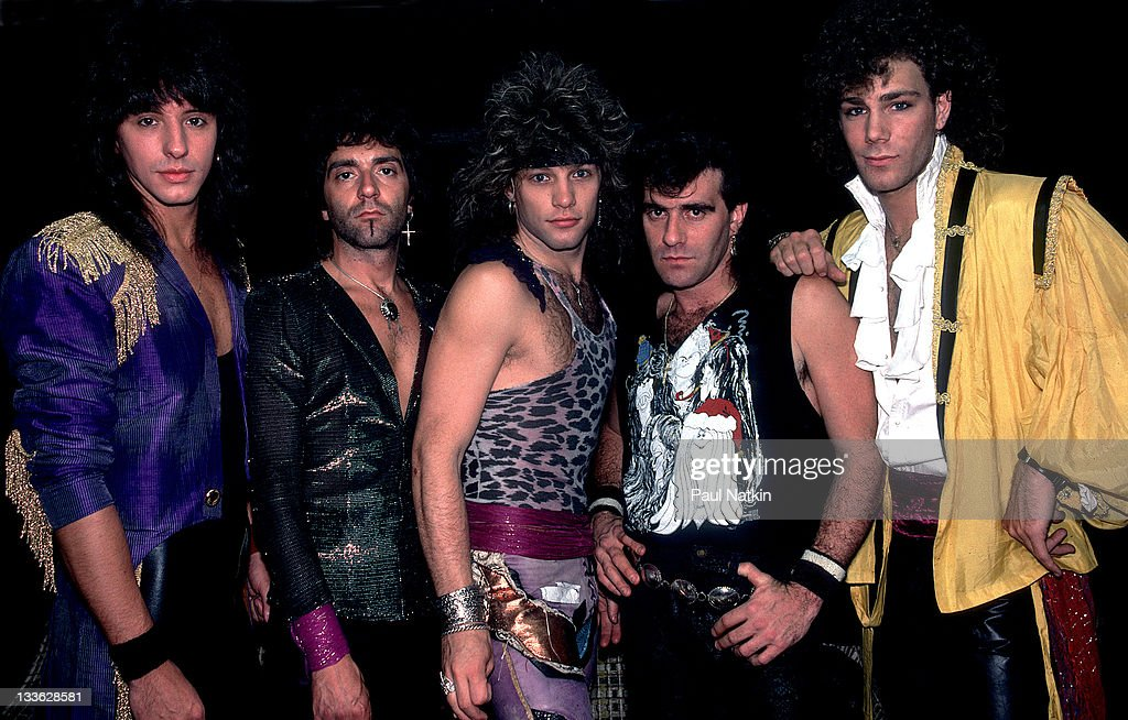 Portrait of American rock band Bon Jovi backstage before a performance at Summerfest, Milwaukee, Wisconsin, June 29, 1985. Pictured are, from left, <a gi-track='captionPersonalityLinkClicked' href=/galleries/search?phrase=Alec+John+Such&family=editorial&specificpeople=1106553 ng-click='$event.stopPropagation()'>Alec John Such</a>, <a gi-track='captionPersonalityLinkClicked' href=/galleries/search?phrase=Richie+Sambora&family=editorial&specificpeople=204195 ng-click='$event.stopPropagation()'>Richie Sambora</a>, <a gi-track='captionPersonalityLinkClicked' href=/galleries/search?phrase=Jon+Bon+Jovi&family=editorial&specificpeople=201527 ng-click='$event.stopPropagation()'>Jon Bon Jovi</a>, <a gi-track='captionPersonalityLinkClicked' href=/galleries/search?phrase=Tico+Torres&family=editorial&specificpeople=241551 ng-click='$event.stopPropagation()'>Tico Torres</a>, and <a gi-track='captionPersonalityLinkClicked' href=/galleries/search?phrase=David+Bryan&family=editorial&specificpeople=211281 ng-click='$event.stopPropagation()'>David Bryan</a>.