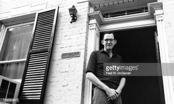 Portrait of American sculptor William King as he poses in the doorway to the Aaron Burr House New York New York January 1964