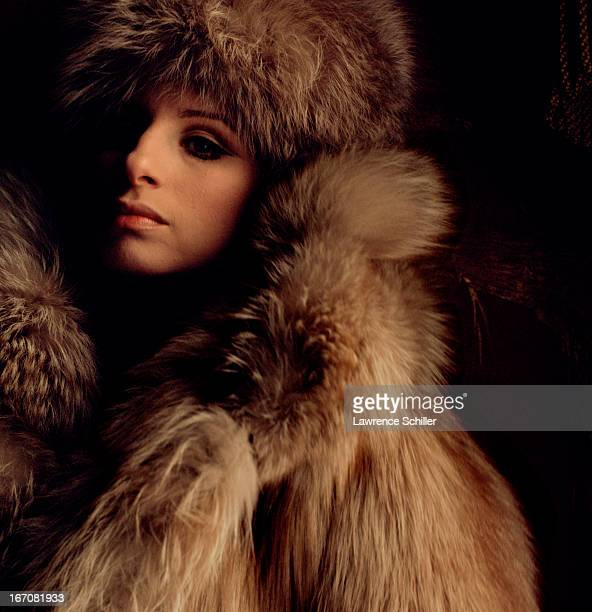 Portrait of American singer and actress Barbra Streisand as she poses in a fur coat and hat New York New York 1969 This picture was taken as part of...