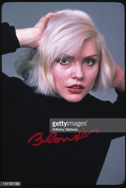 Portrait of American singer Debbie Harry from the band Blondie as she poses against a grey background New York New York1970s
