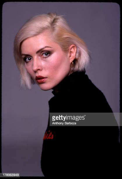 Portrait of American singer Debbie Harry of the band Blondie as she poses against a grey backdrop New York New York 1970s