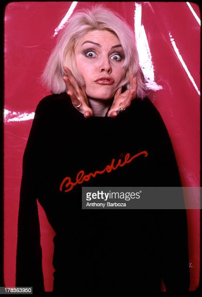 Portrait of American singer Debbie Harry of the band Blondie as she poses against a vinyl backdrop New York New York 1970s