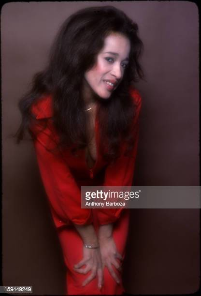 Portrait of American singer Ronnie Spector of the Ronettes as she poses in a red jumpsuit 1978