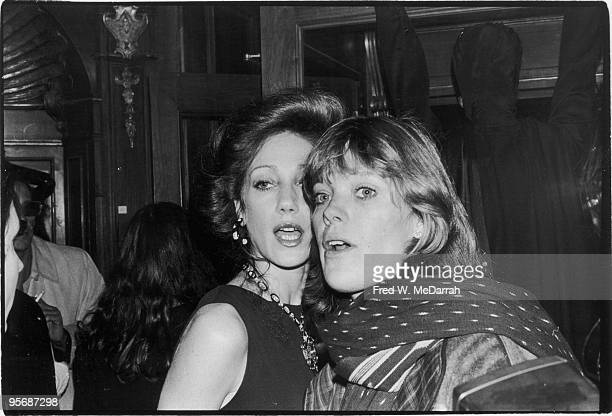 Portrait of American sisters model and actress Marisa Berenson and photographer Berry Bereson as they pose together at a Rizzoli fashion show New...