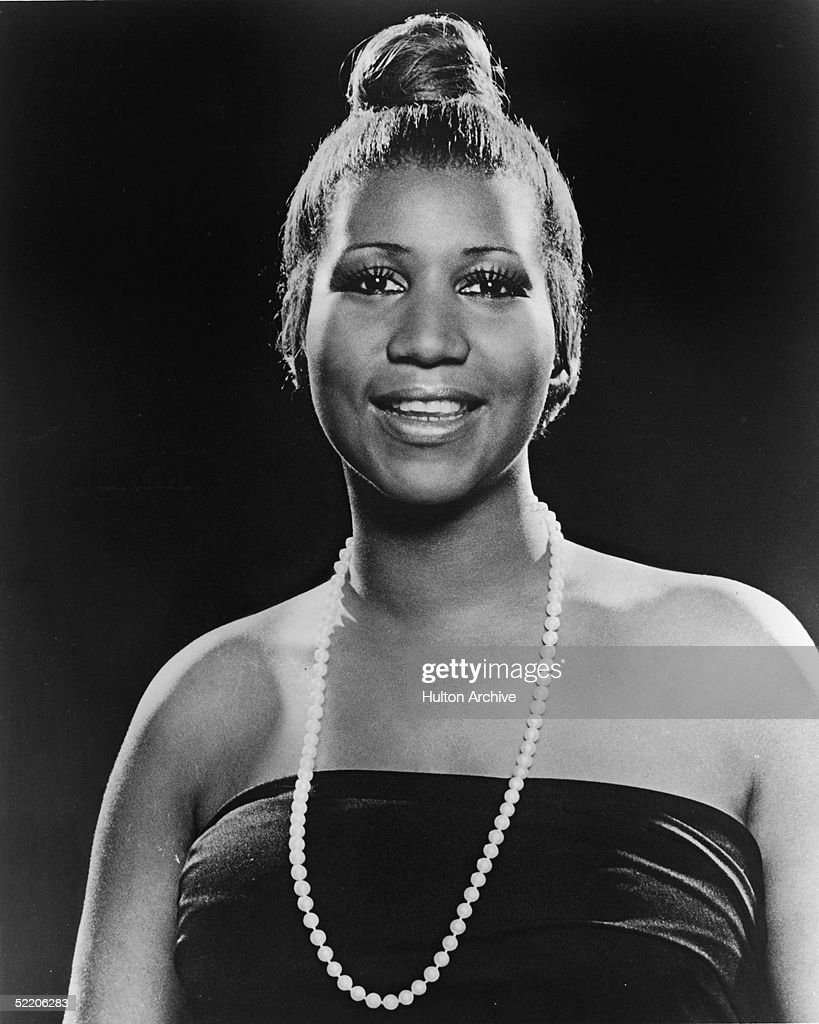 Portrait of American soul singer Aretha Franklin as she wears a strapless dress and pearl necklace and has her hair in a bun, 1977.