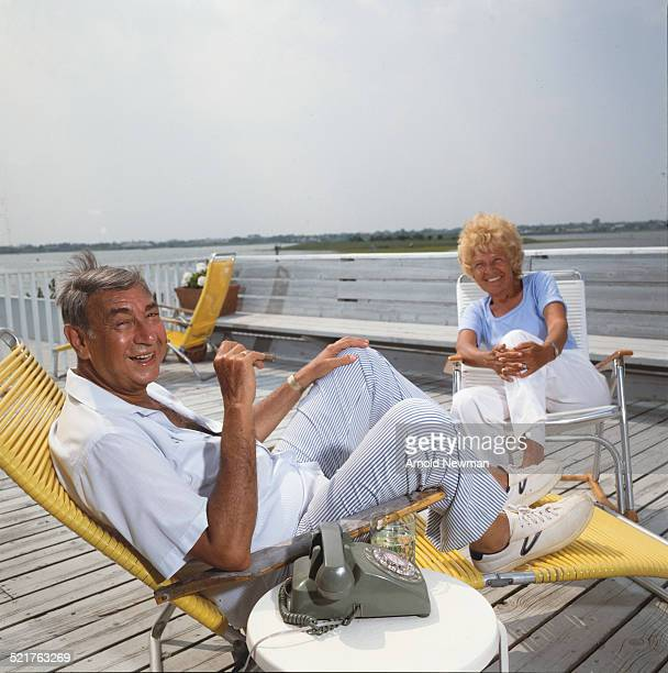 Portrait of American televison sports journalist Howard Cosell and his wife Emmy as they sit on a wooden deck West Hampton New York July 16 1983