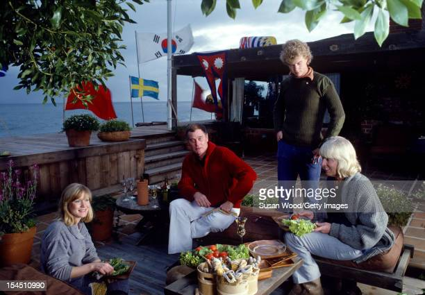 Portrait of American televison actor Larry Hagman and his family as they sit on the deck of their beachfront home Malibu California January 1980...