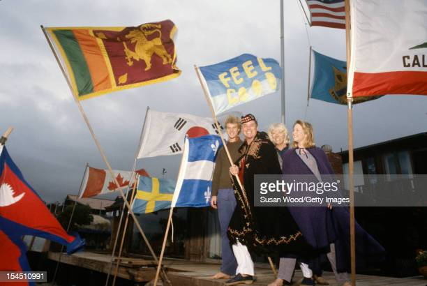 Portrait of American televison actor Larry Hagman and his family as they pose with a number of flags at their beachfront home Malibu California...