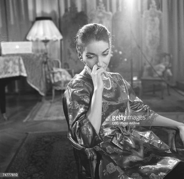 Portrait of Americanborn Greek opera singer Maria Callas sits in a chair during the filming of an episode of 'Small World' December 1958 The epsiode...