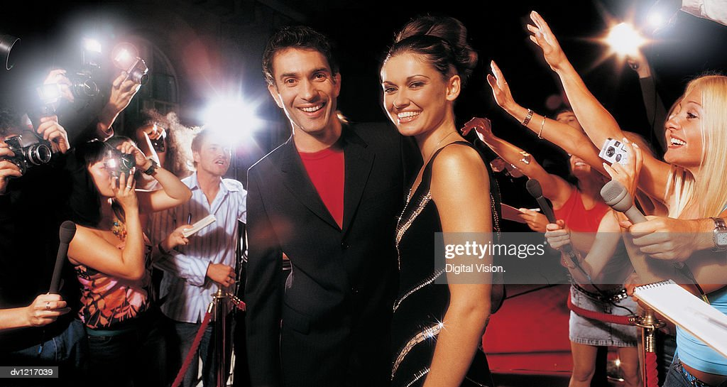 Portrait of an Actor and Actress and a Group of Fans : Stock Photo