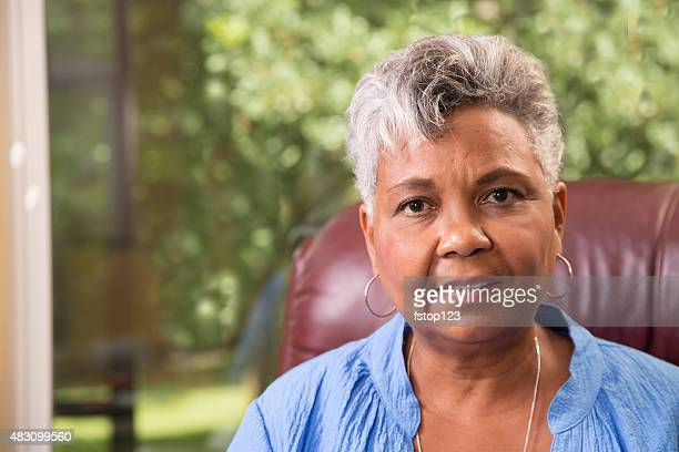 Portrait of an African descent senior woman at home.