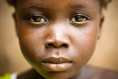 A portrait of an African girl with a sad expression