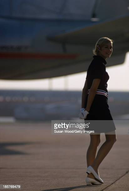 Portrait of an American Airlines air stewardess as she poses in uniform on an airport tarmac September 1967 The photo was taken as part of a...