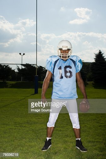 Portrait of an american football player : Stock Photo