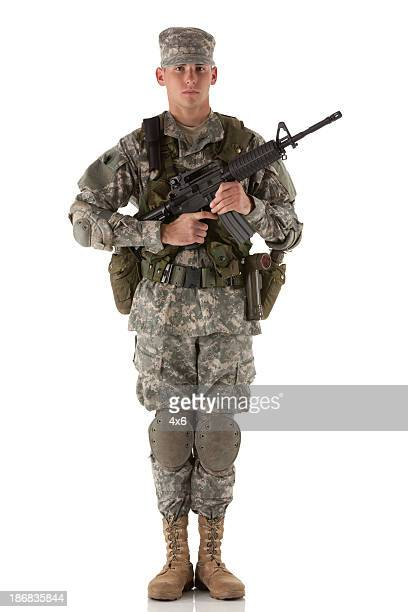 Portrait of an army man holding a rifle