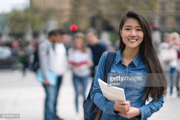 Portrait of an Asian student outdoors looking at the camera smiling