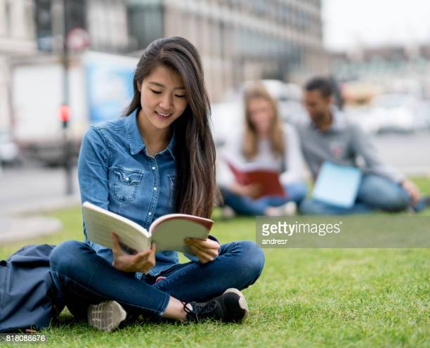 Portrait of an Asian student studying outdoors