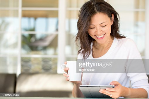 Portrait of an Asian woman smiling. : Stock Photo