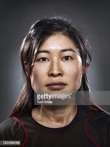Portrait of an Asian woman with sweaty brow : Stock Photo