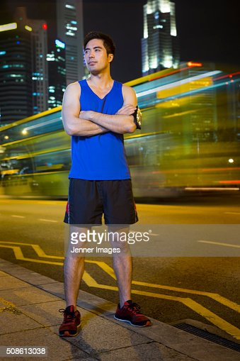 Portrait of an athletic Asian man at night. : Stock Photo