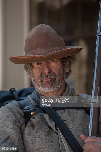 Portrait of an authentic-looking Civil War Confederate soldier reenactor