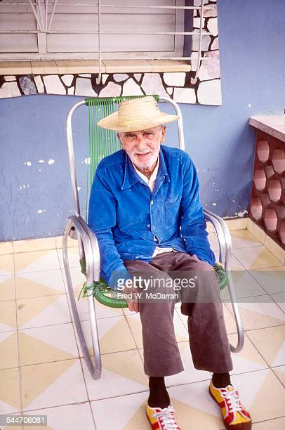 Portrait of an elderly man as he sits in a rocking chair on his porch Old Havana Cuba January 1983