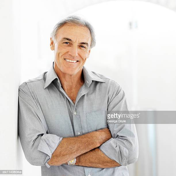 portrait of an elderly man leaning against a wall