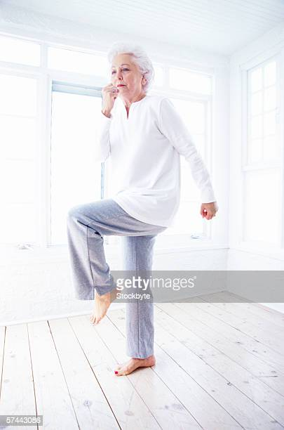 portrait of an elderly woman exercising
