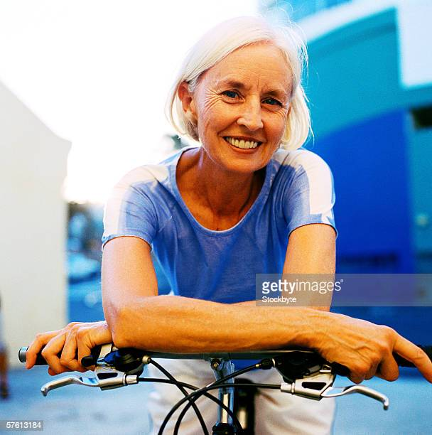 Portrait of an elderly woman on a bicycle
