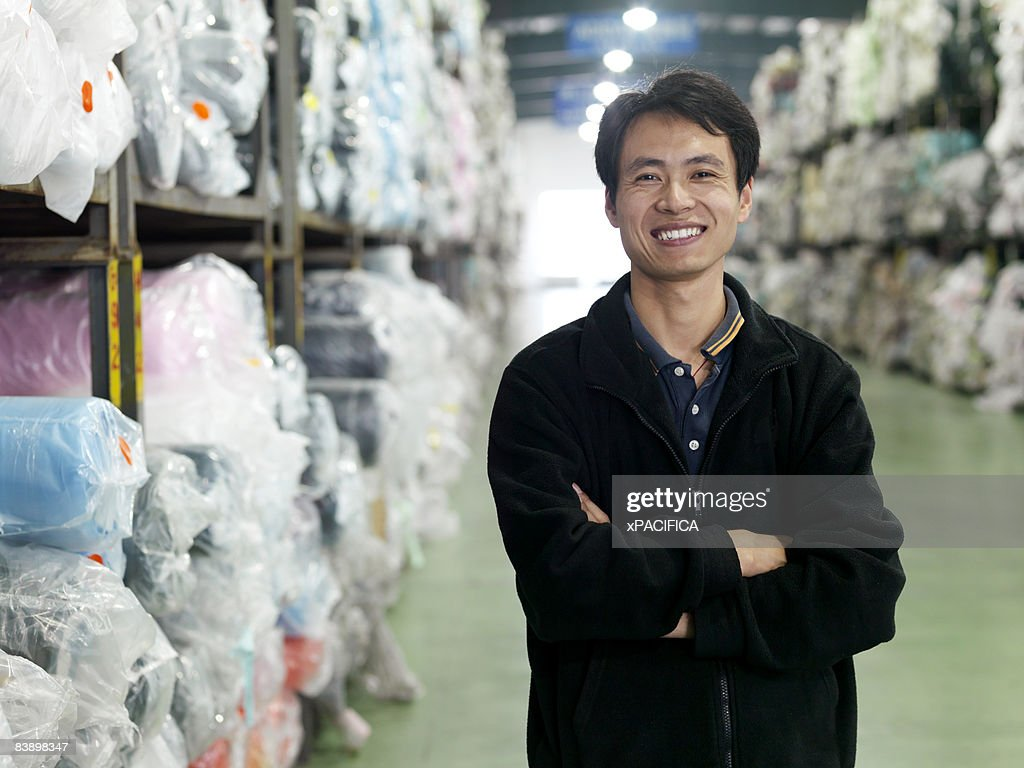 A portrait of an employee of a textile factory. : Stock Photo