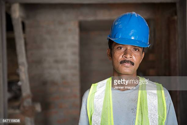 Portrait of an Indian construction worker.