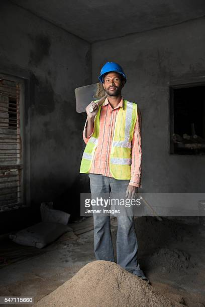 Portrait of an Indian man at a construction site.