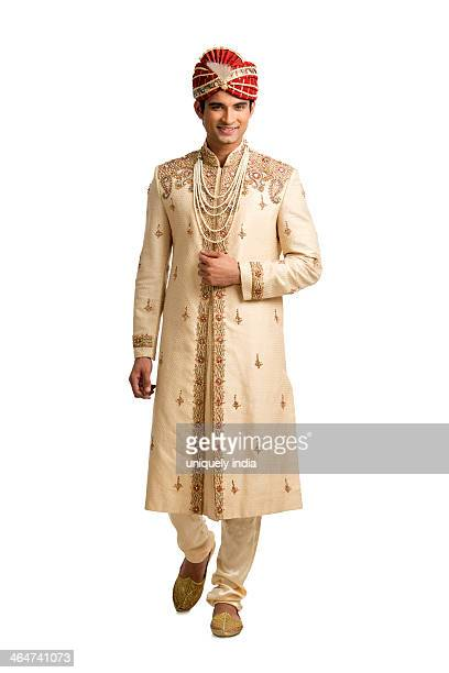 Portrait of an Indian man in traditional wedding outfit