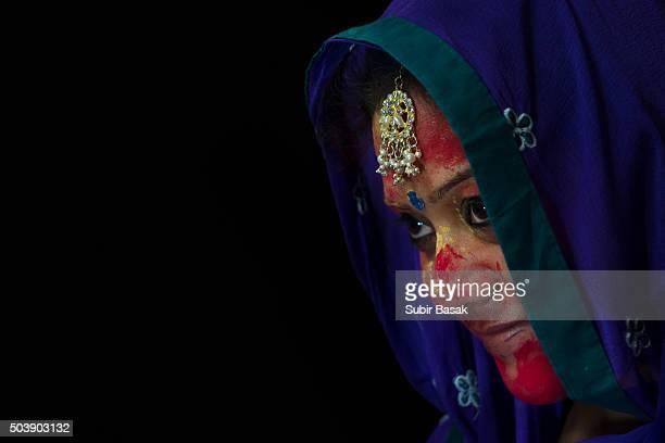Portrait of an Indian veiled woman celebrating holi.