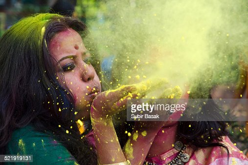 Portrait of an Indian woman celebrating Holi