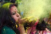 Portrait of an Indian woman celebrating Holi