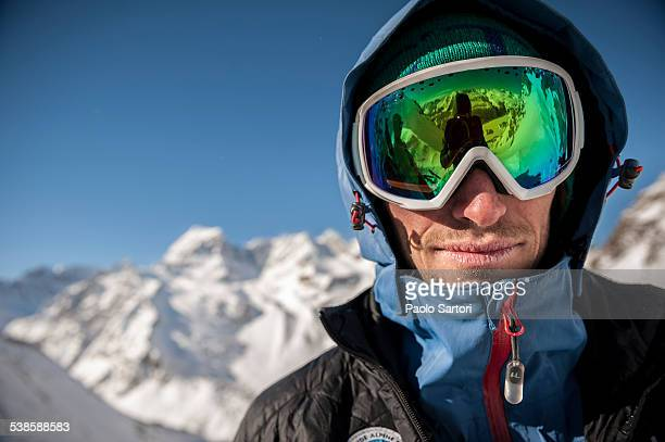 Portrait of an italian Alpine Guide taken during a ski tour on the Alps above Devero. Baceno, Ossola, Italy.