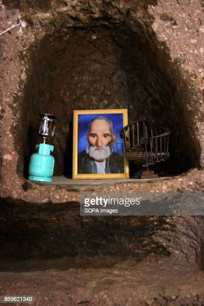 A portrait of an old man is seen inside a local house The tiny village of Kandovan in the Iranian East Azerbaijan Province is known for its cliff...