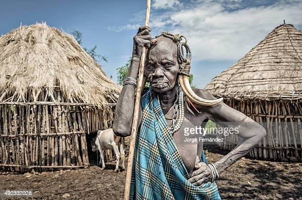 Portrait of an old Mursi woman with typical ornaments
