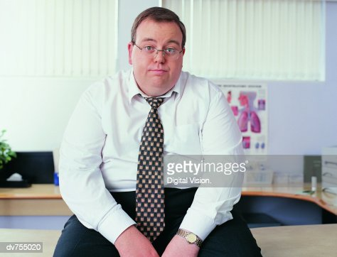 Portrait of an Overweight Businessman in a Doctor's Office