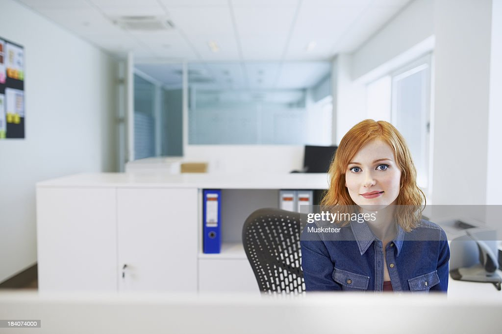 Portrait of an redhaired officeworker : Stock Photo