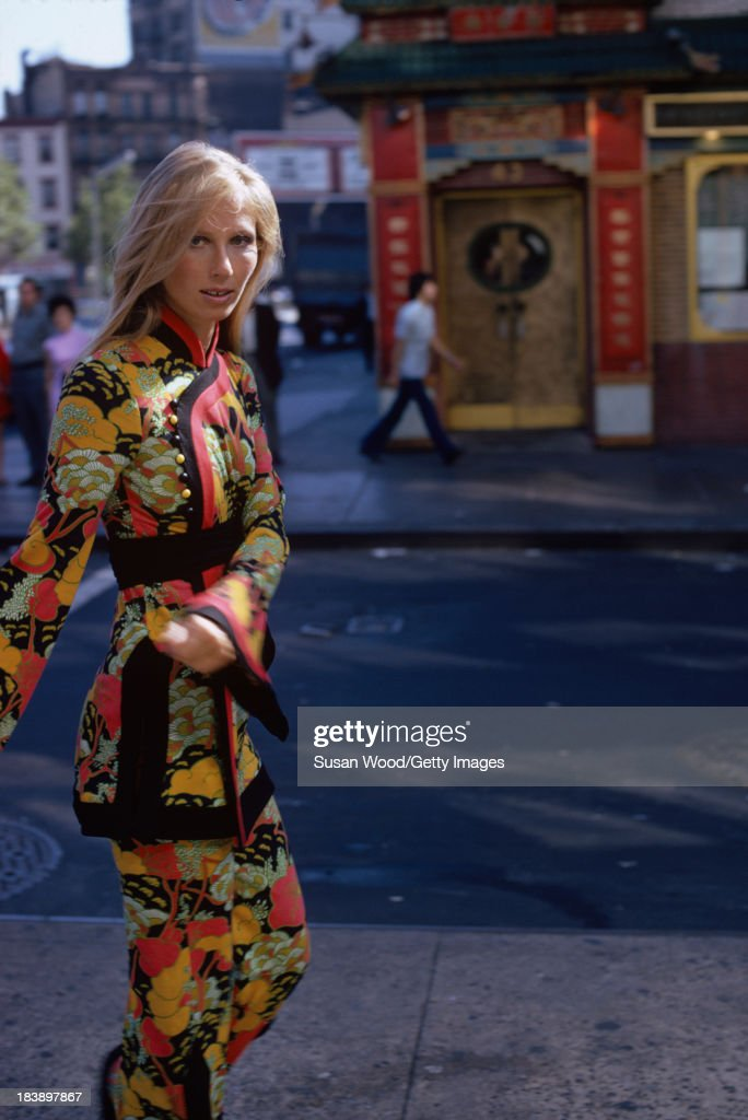 Portrait of an unidentified model dressed in a two-piece, print trouser suit as she poses on the streets of Manhattan's Chinatown, New York, New York, August 1971. The clothing, a Chinese-inspired design by John Weitz, was featured in this fashion shoot for New York magazine.