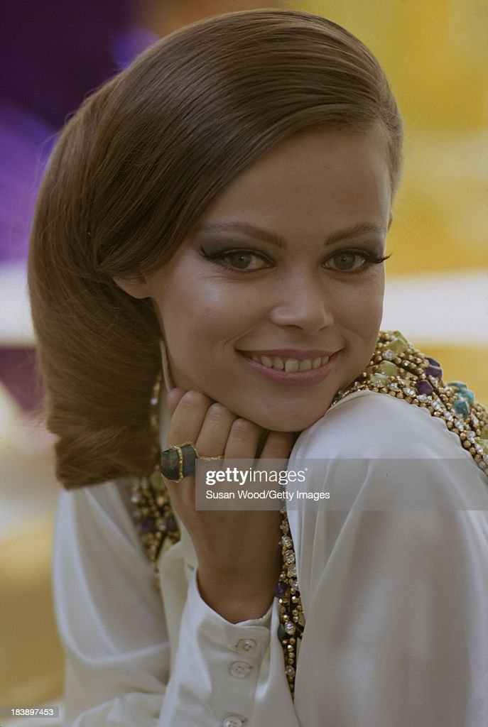 Portrait of an unidentified model dressed in a white blouse, a jewel-embossed waistcoat, and a blue stone ring, August 1971. The image was taken during a fashion shoot for British Vogue magazine.