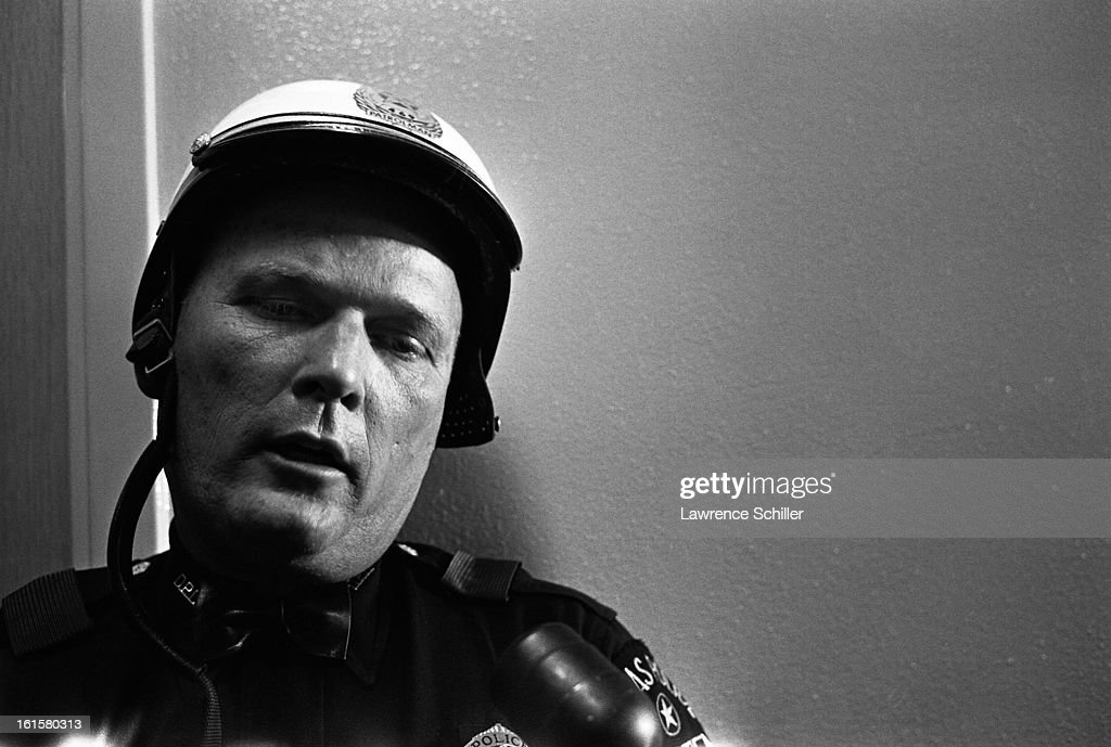 Portrait of an unidentified motorcycle police officer who had ridden in President John F. Kennedy's motorcade at the time of his assassination, Dallas, Texas, late 1963.