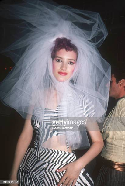 Portrait of an unidentified partygoer at the nightclub Studio 54 New York New York late 1970s or early 1980s She wears a large taffeta headpiece and...