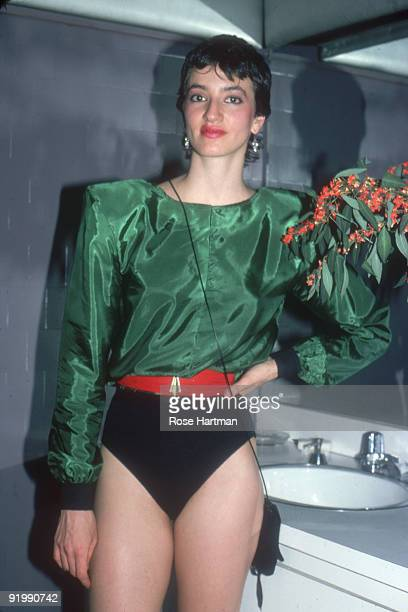 Portrait of an unidentified partygoer in the restroom at the nightclub Studio 54 New York New York late 1970s or early 1980s She is dressed in a...