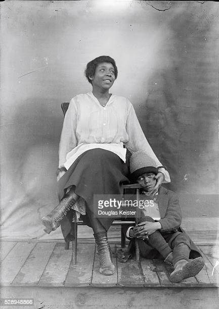This woman and boy are unidentified but surely the photograph captures a mother's reassuring touch A dried tear traces down the boy's cheek