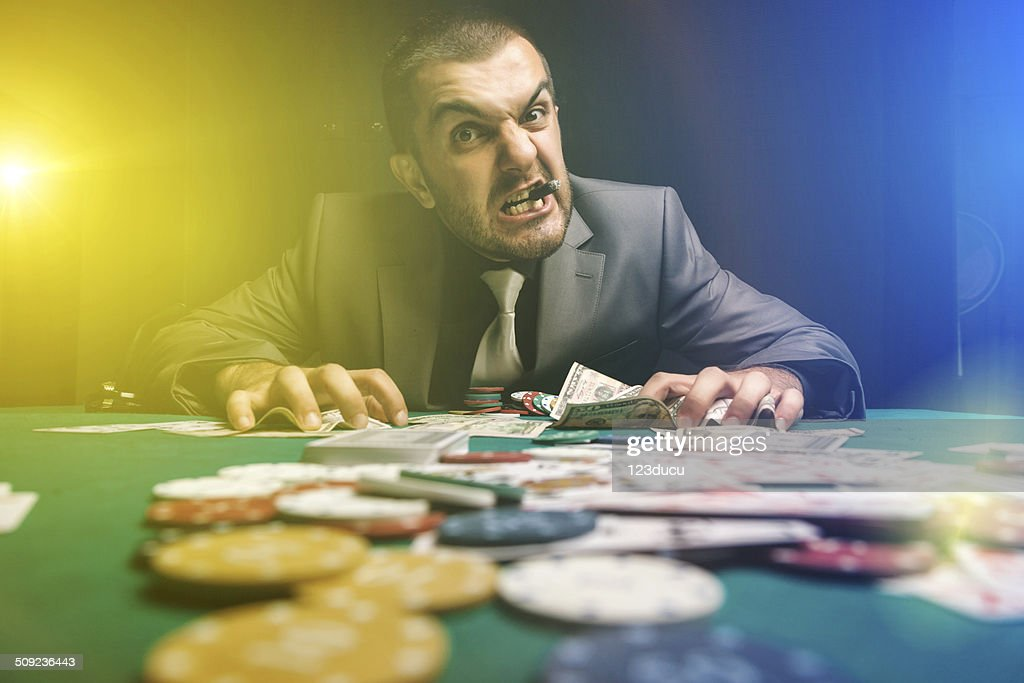 Portrait of angry gambler